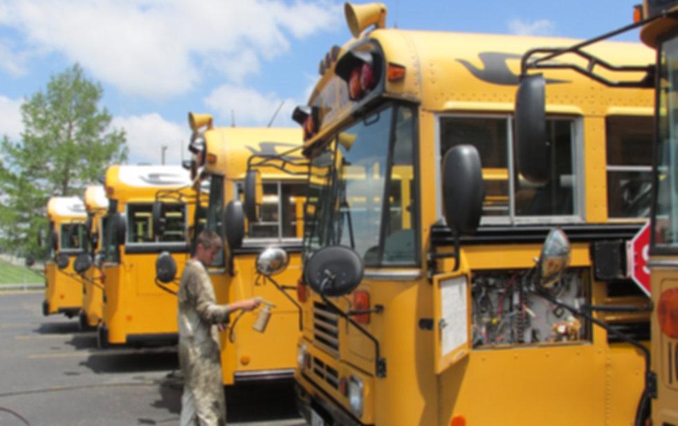 Wyandot RustProofing rust proofing school buses.