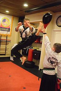 A karate guy kicking