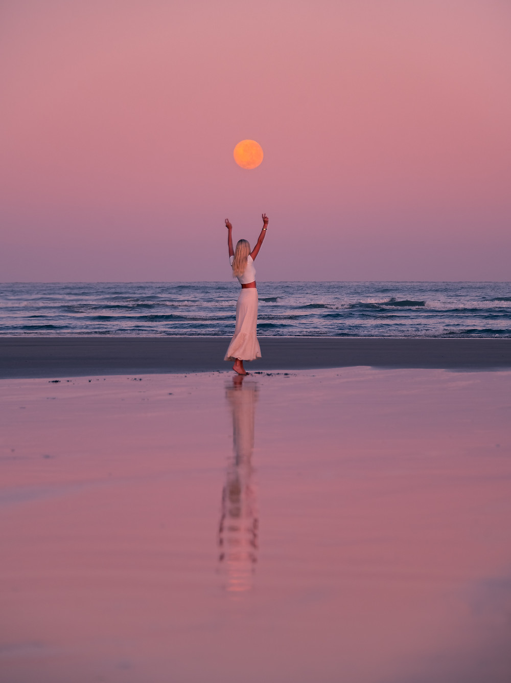 full moon rise with girl over wharariki beach