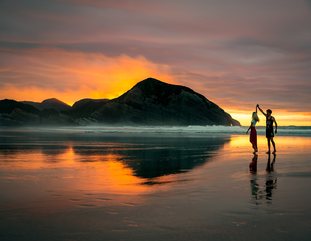 couple dancing at sunset at wharariki beach