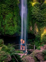 travel couple at pucak manik waterfall bali