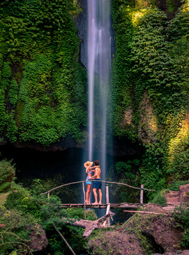 travel couple at pucak manik tall waterfall bali