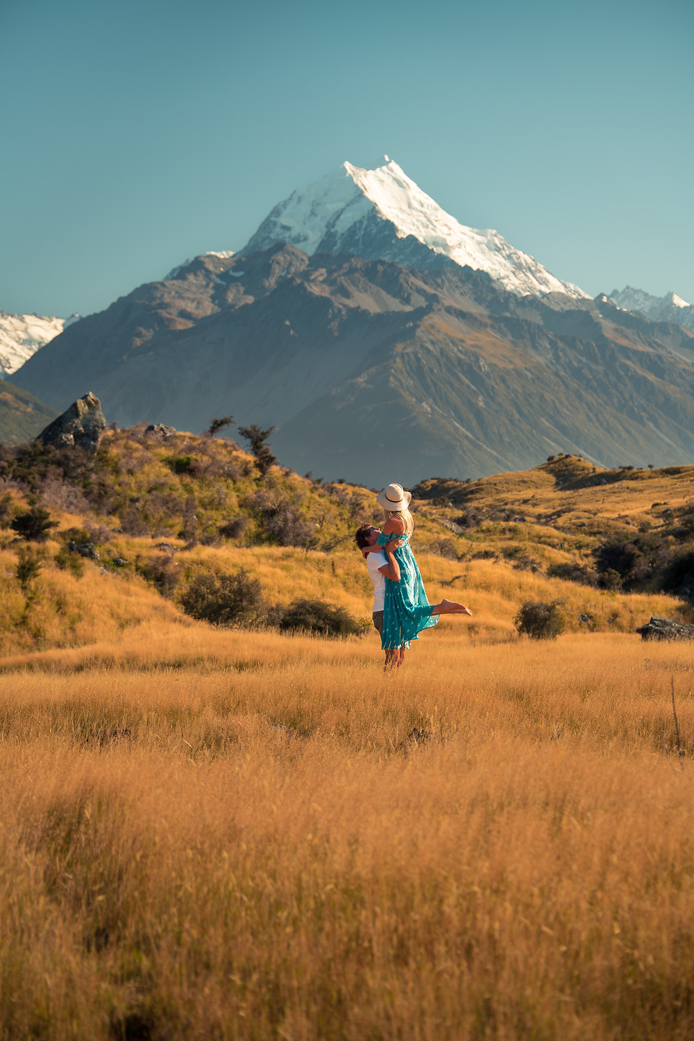couple with man lifting woman in front of mt cook