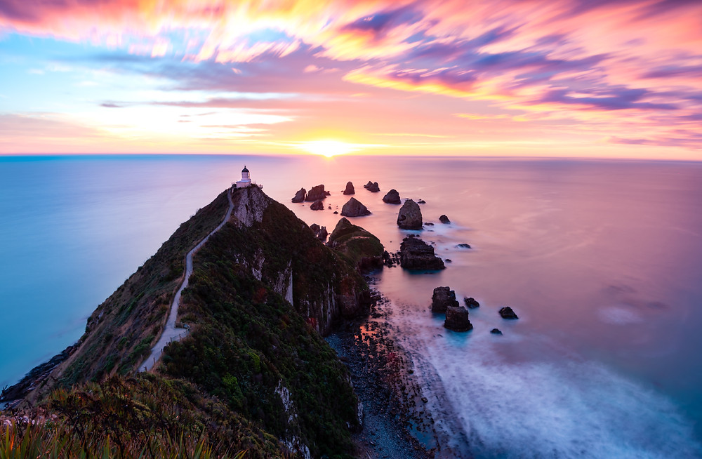 sunrise over nugget point lighthouse long exposure photography
