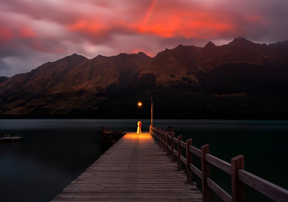 sunrise on glenorchy pier with couple in light
