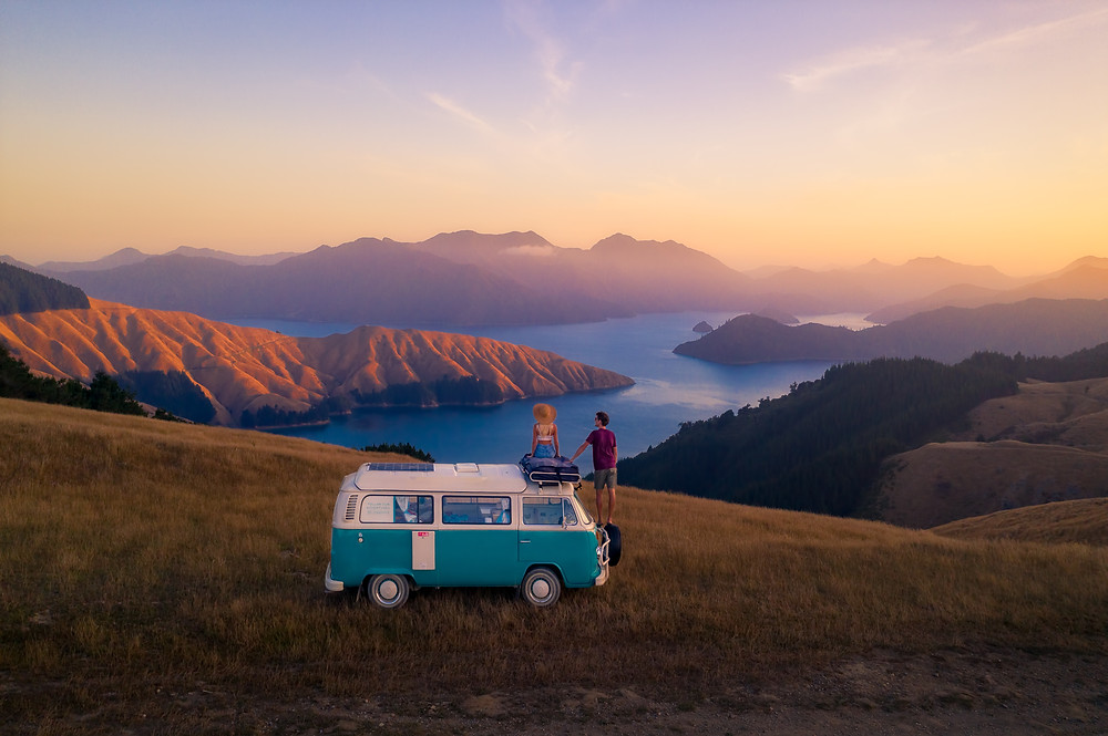 couple on kombi overlooking marlborough sounds from the french pass