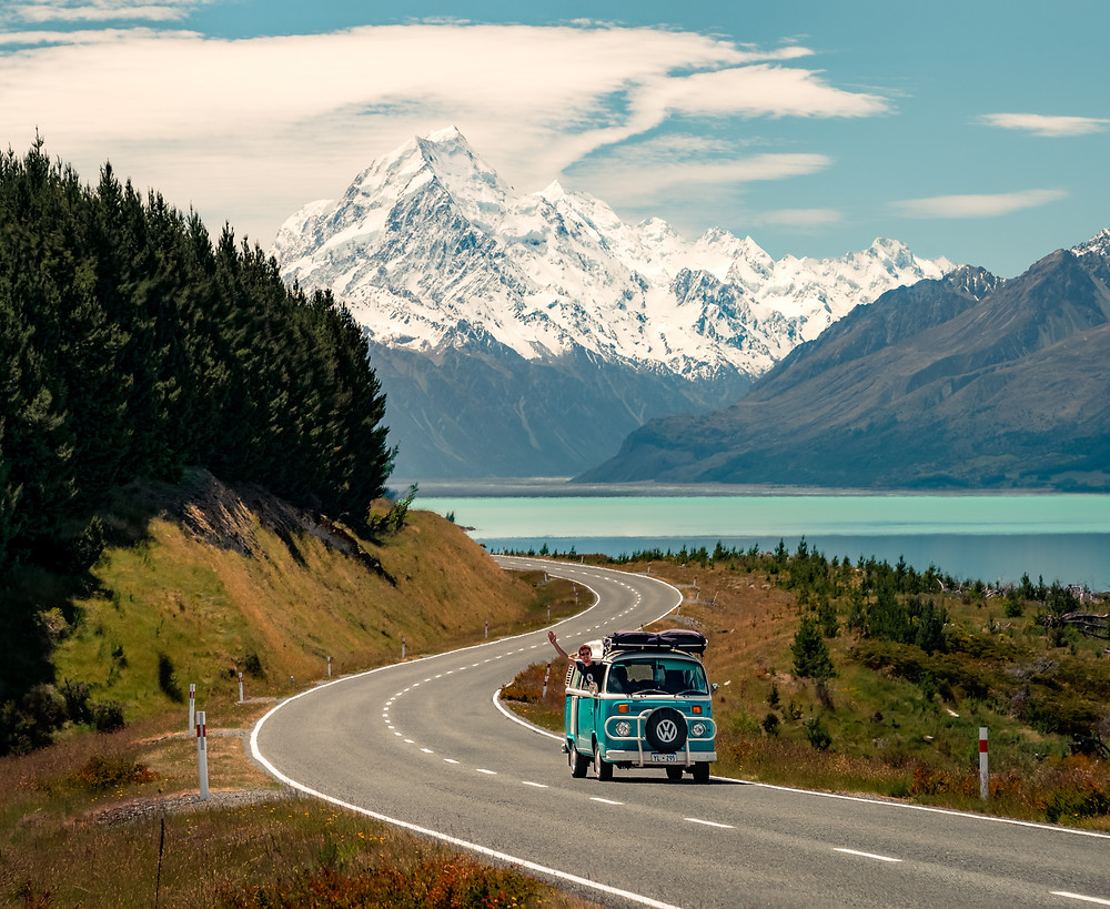 kombi van driving in front of mt cook and lake pukaki