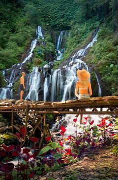 travel couple at pucak manik wide waterfall bali