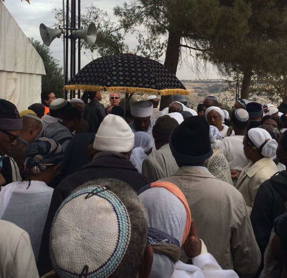 The Kessim (religious leaders) are located under the tent and are leading the prayers. The area of prayer is very small and crowded.