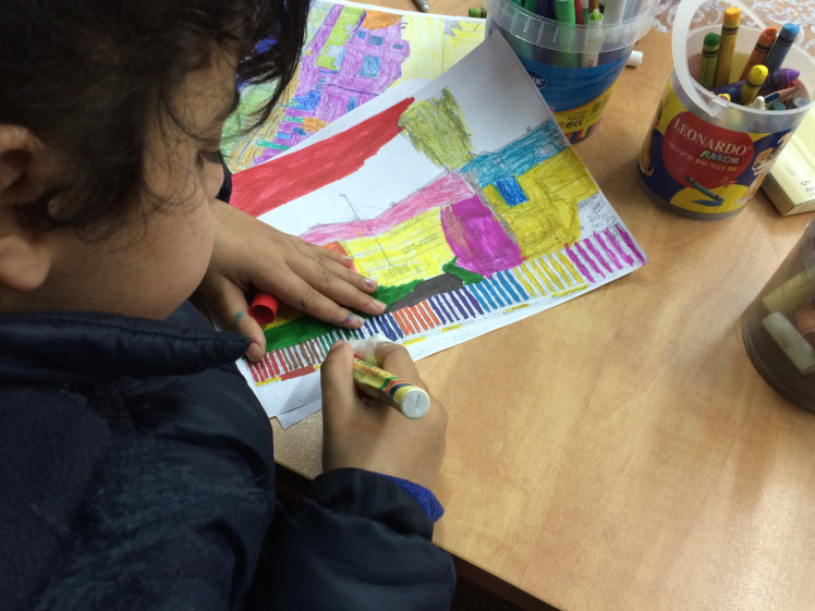 Colouring a picture of Matnas Chicago at an Arab youth after school homework program.