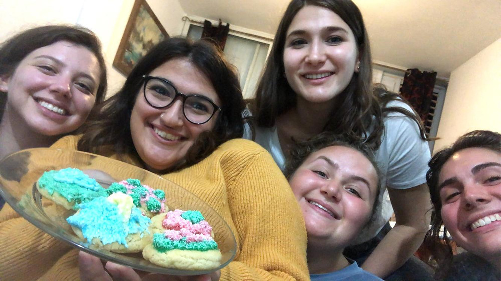 The author, far left, and her roommates with their Hanukkah cookies.