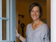 Michelle DeWolf Health Coaching, photo of Michelle opening her front door