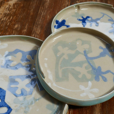 Stoneware plates with oxide coloured slips