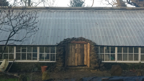 Greenhouse with hobbit door.