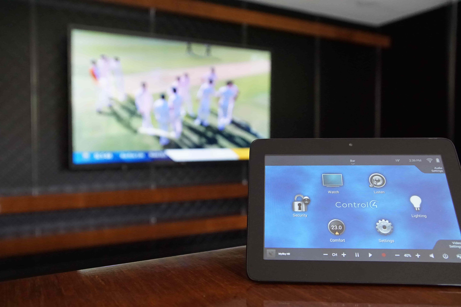 Control4 touch screen and TV at Marshlan