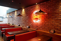 Sal's Pizza booths with feature lighting