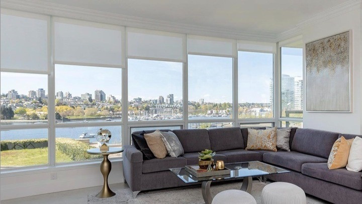 Motorised blinds in a living room with a view