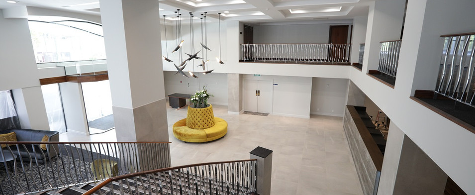 The Distinction Hotel lobby and staircas