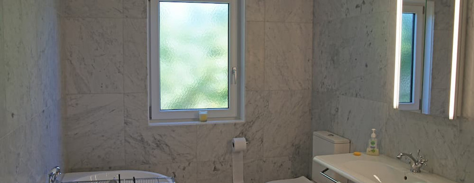 Holly road bathroom with automated blind control, lighting and fan