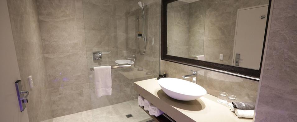 The Distinction Hotel bathroom