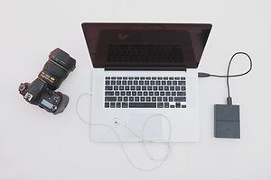 Computer, camera, hard drive and earbud headphone_edited.jpg
