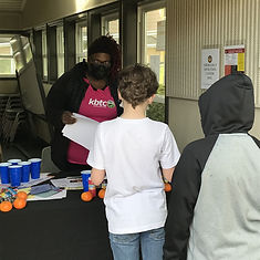 LaMekia provides activities and directions for two boys at Tacoma Housing Authority
