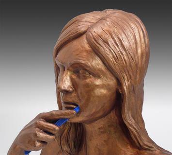 Woman Brushing Teeth