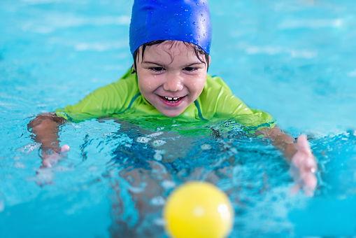 cute-little-child-having-fun-in-a-swimmi