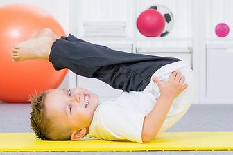 Little boy on yoga matt.jpeg