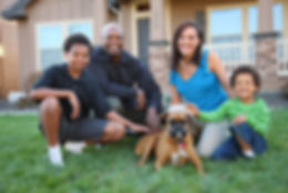 Family with dog in grass by home.jpg