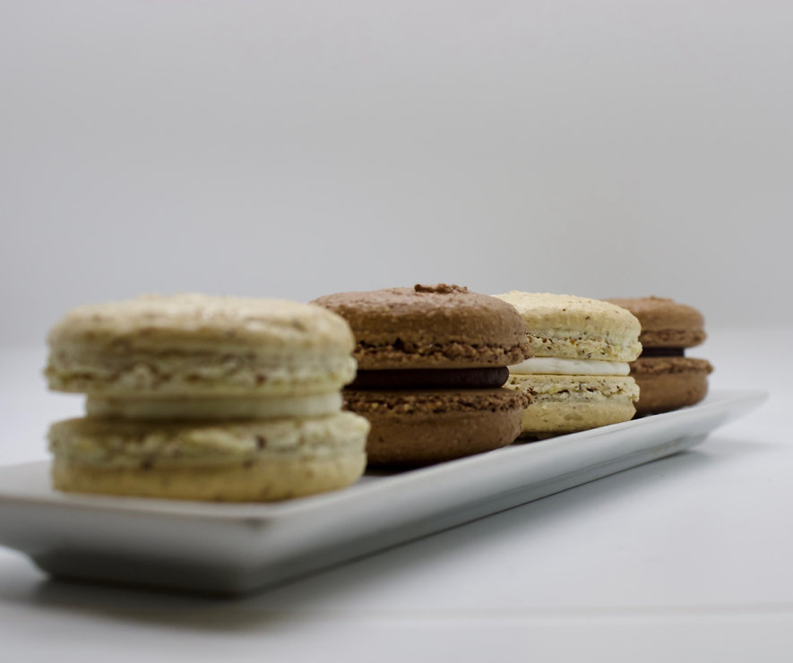 Two Chocolate and Two Vanilla French Macaroons