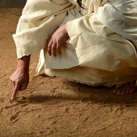 Jesus Writing on the sand with his finge