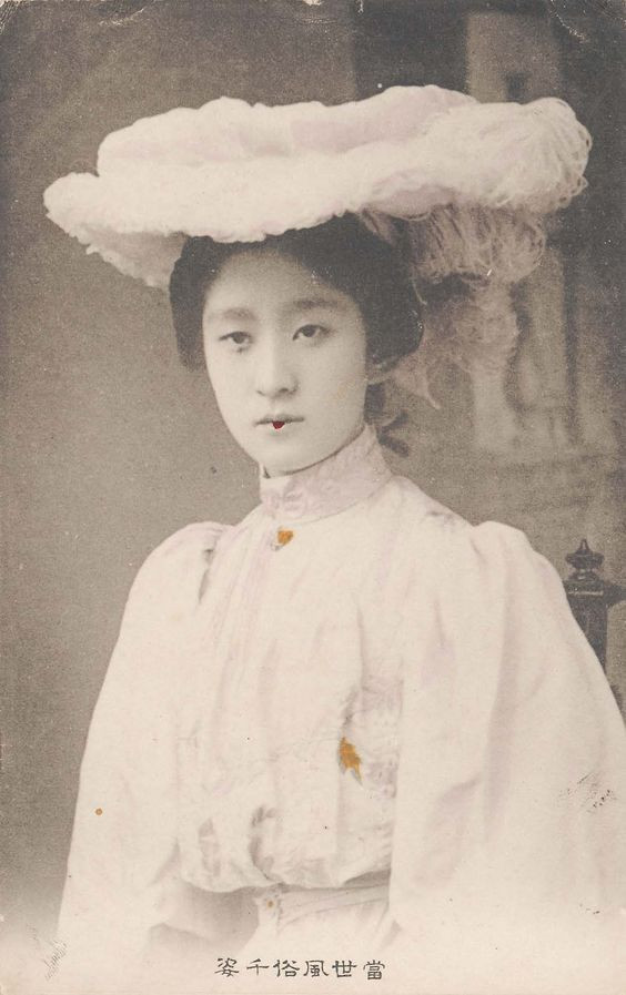 Japanese woman in Western dress cookingwiththehamster