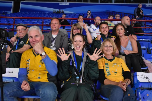 Australian team and support with athlete Bec Rooney to the fore celebrate Luke Thompson's win.