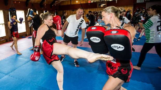 Leanne Friar, left, works on her kick along with Holly Snowdown ahead of Eruption 10.