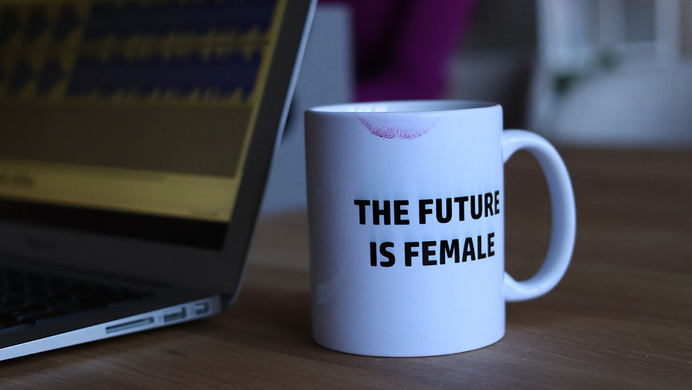 """Cup with """"the future is female"""" written on it"""