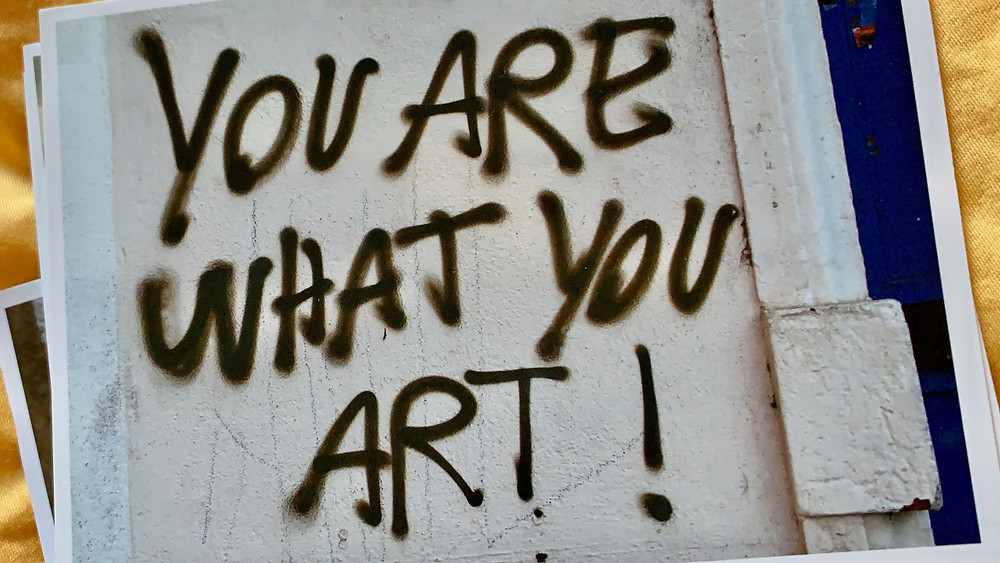 """paper with """"your are what you art"""" written on it"""