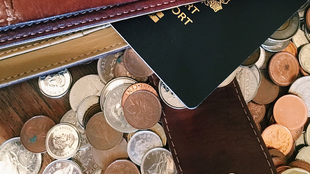 passport and coins on a table