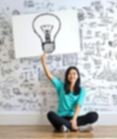woman-draw-a-light-bulb-in-white-board-3