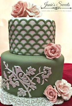 green and peach wedding cake
