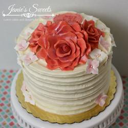 Buttercream cake with fondant flowers