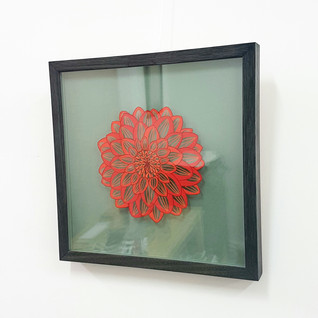 Box frame with artwork floated between two sheets of glass