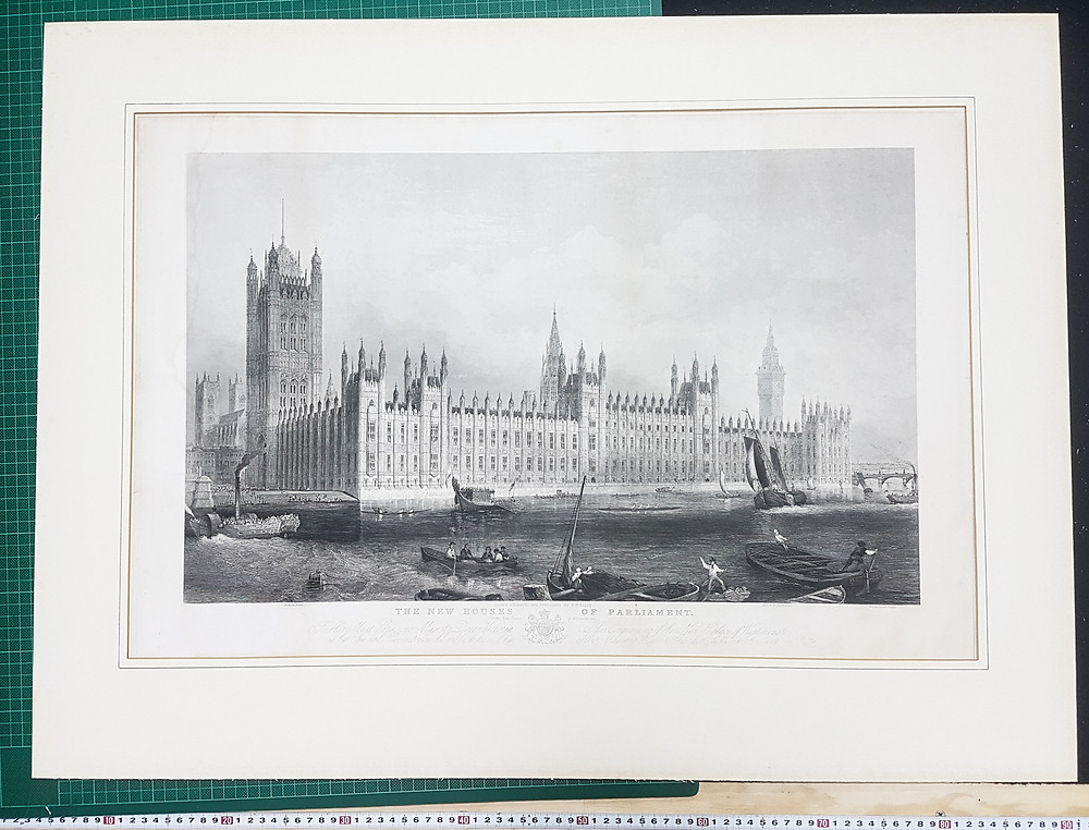 An antique print removed from its frame to reveal damage caused by outgassing from the mat