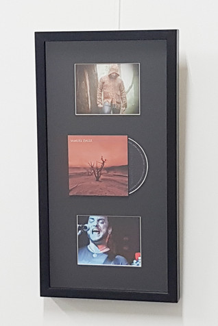 Float-mounted CD and cover. India ink and boot polish finish