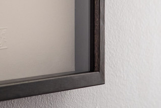 Detail of box frame with timber spacers. Ebonized with oil and wax finish.