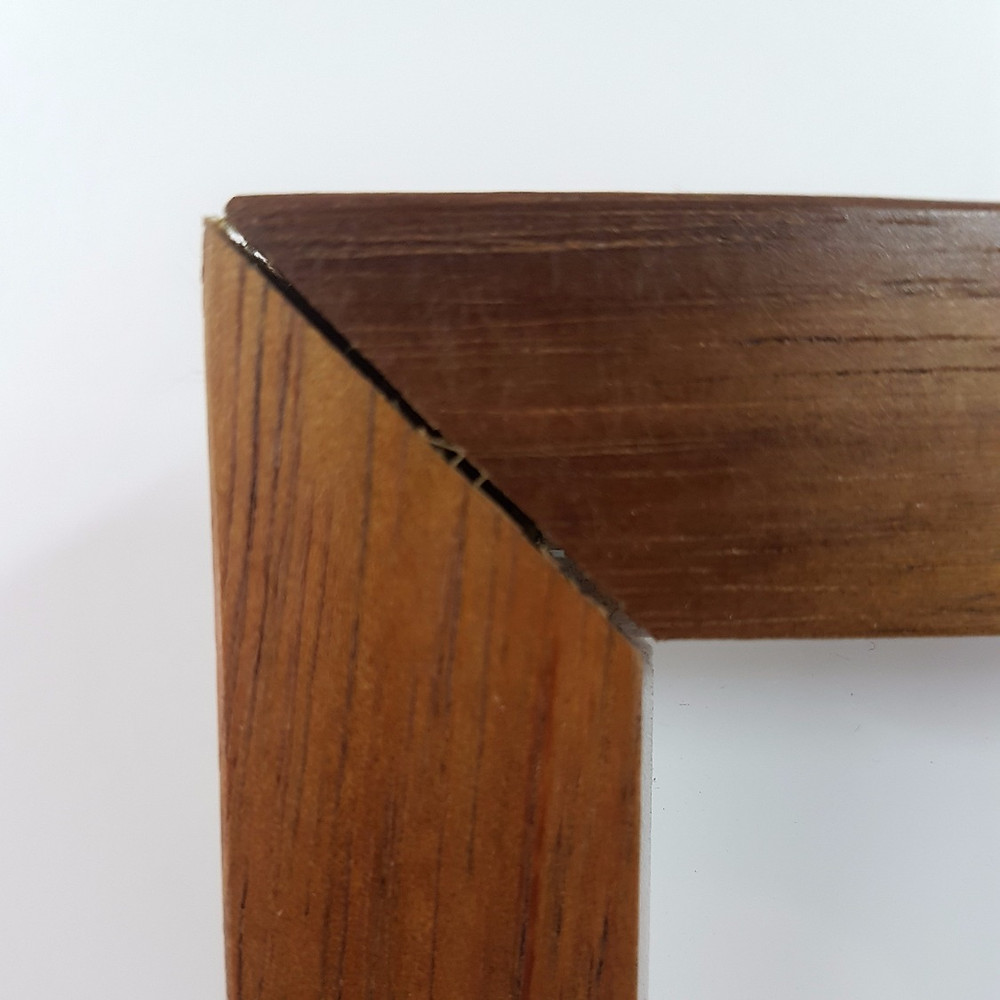 Cracked mitre caused by the expansion of perspex within the frame