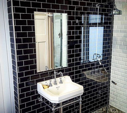 One seriously cool bathroom._Need something into tiles_ _No problems at all!_Need it on the wall, gi
