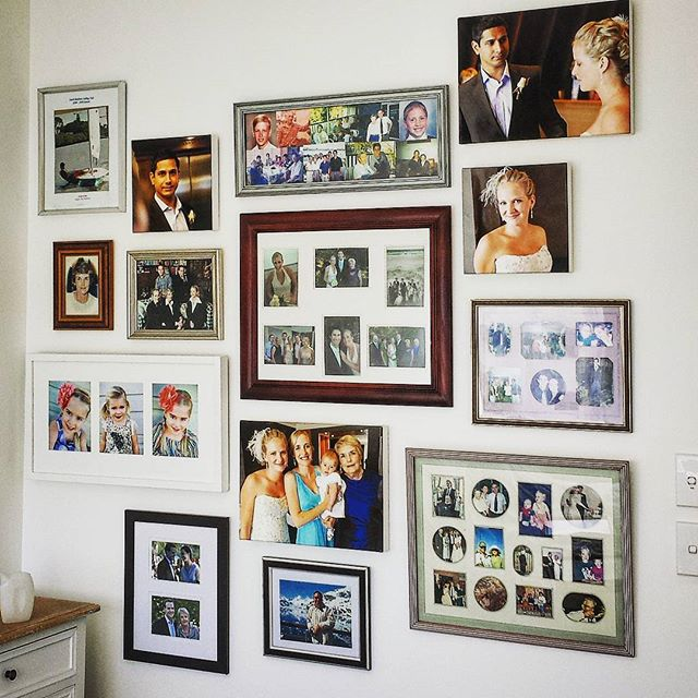 Would you like a wall like this in your home_ Then grab all the photo frames you can find, give us a