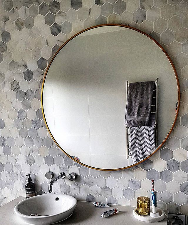 Hanging some beautiful mirrors in a newly renovated home today