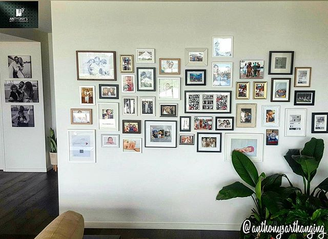 Happy Family Photo Wall Friday!! I love hanging these family photo walls or Cluster walls